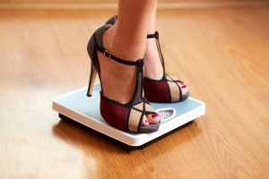 Female Feet In Color Stilettos With Weight Scale