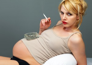 Found this o a stock photo site...it's called 'Pretty pregnant with a cigarette and ashtray' - man that is niche...